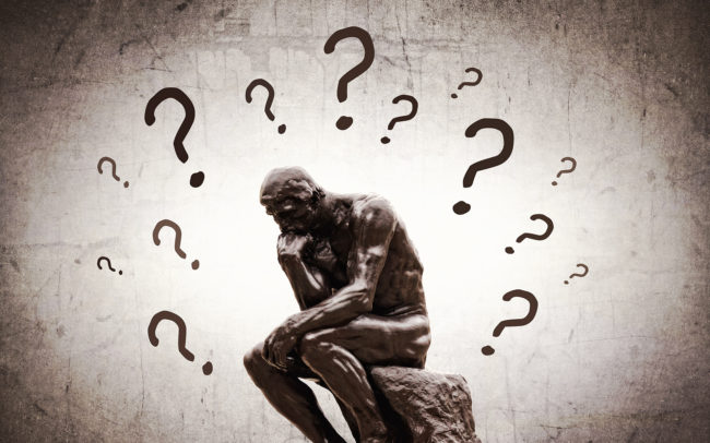 Rodins Thinker surrounded by question marks - Doubts and insecurities concept